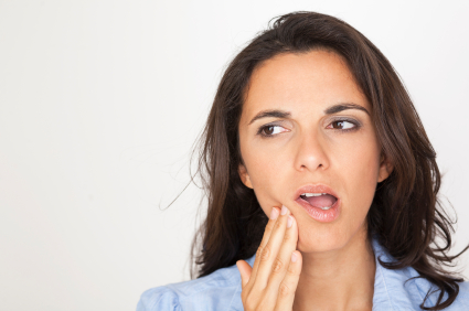 Woman in need of gum disease treatment at Fox Dental Excellence in Mason, OH.