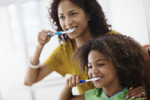 Mason, OH family brushing their teeth before visiting the dentist.