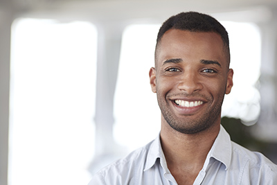 Image of a man smiling. Learn more about the benefits of dental fillings by Fox Dental Excellence in Mason, OH.